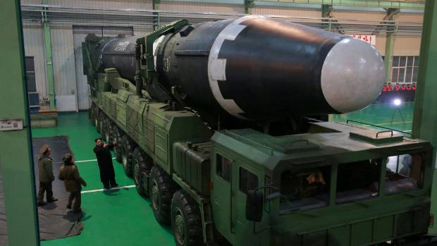 North Korea's leader Kim Jong Un with the newly developed intercontinental ballistic missile Hwasong-15 which was