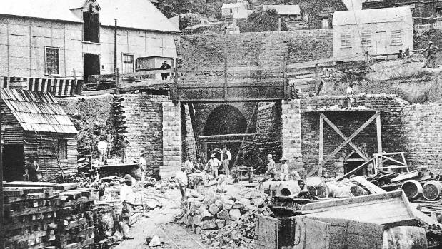 The tunnel under construction, with provincial engineer, Edward Dobson in his distinctive white top hat, to the right of ...