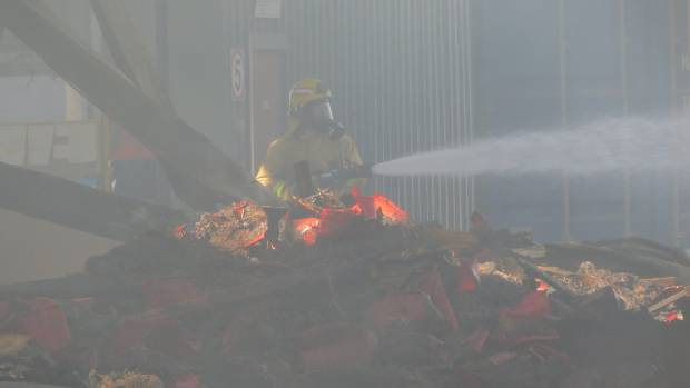 Firefighters were expected to be at the scene dampening down hotspots most of Tuesday.
