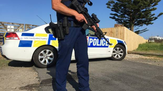Armed police at the Highway 61 gang pad in Norman St, Waitara, in December after a ram-raid and shooting. (file photo)