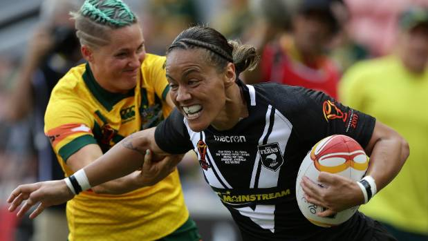 New Zealand's Honey Hireme busts a tackle during the World Cup final against Australia.