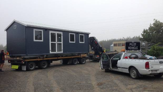 Theoretically Wightman's tiny homes can be towed on their own wheelbase, but this one has a longer  journey to its new site.