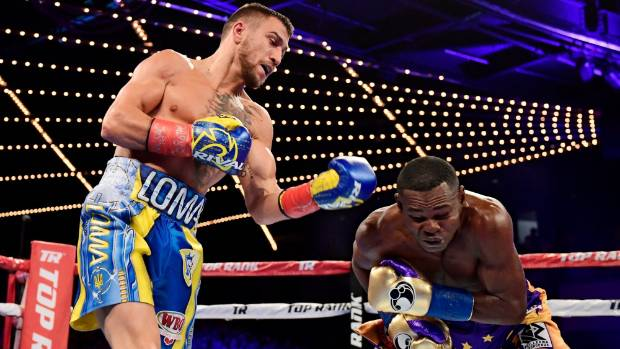 Lomachenko stops Rigondeaux to retain WBO world title