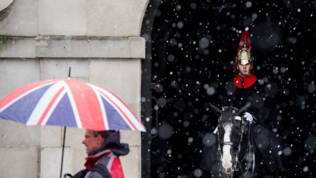 Snow falls briefly in London with many other parts of the country hit by the cold weather