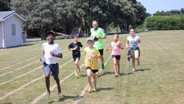 Jason Reid ran around the Hāwera Primary School field as part of his 12 Days of Christmas Challenge - he was joined by ...