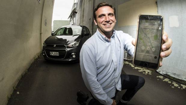 Uber New Zealand general manager Richards Menzies displaying the ride sharing app, which will go live in Hamilton on ...