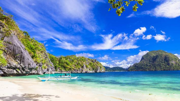The White Sand Beach Of El Nido In Palawan Is Regarded As One