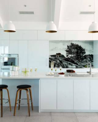 This All White Kitchen In A Mangawhai Bach Features A Striking Mural In  Place Of