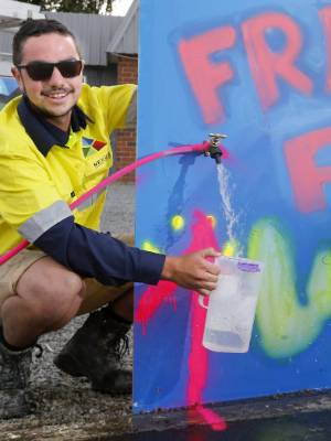 Plumbing apprentice Logan Kirke fills up a jug with the tap, stationed out front of the Temuka business on King St.