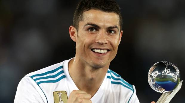 Ronaldo linked to epl comeback with manchester united or chelsea cristiano ronaldo of real madrid celebrates with his golden ball trophy after the fifa club world stopboris Gallery