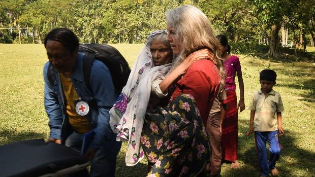 Australian doctor Debra Blackmore carries Jamila Khatun at Dum Dumiya refugee camp.