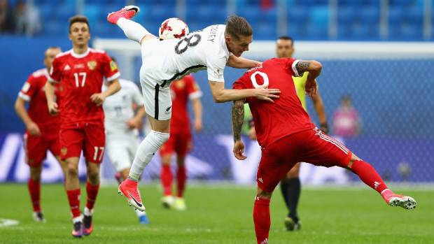 kip colvey and fedor smolov battle for possession during the cup match between the all