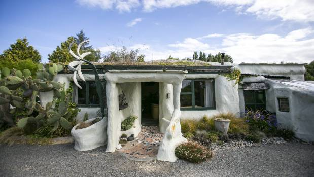 terry and lisas tuahiwi home affectionately known as the flintstone house is as quirky - Flintstone House