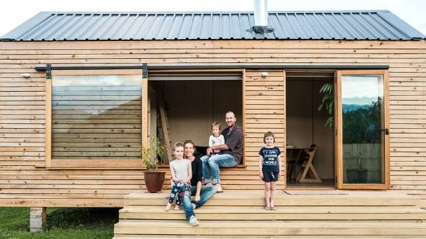 Napier residents Francois and Sarah-Lee Guittenit have chosen to bring up their three young children in a tiny house ...