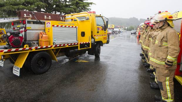 Fellow firefighters pay their respects to Greg Mauchline, who was taken on one last ride in the Upper Hutt Rural Fire ...