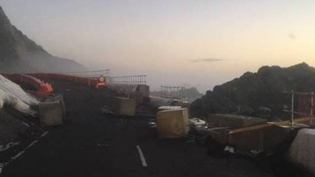 Five-tonne concrete blocks from a temporary sea wall at Ohau point were swept onto SH1 on Sunday night.