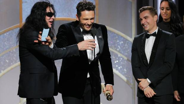 """James Franco, center, accepting the award for best actor in a motion picture comedy or musical for his role in """"The ..."""
