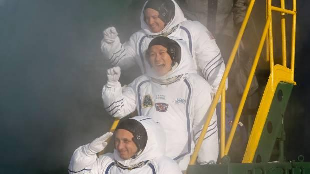 Russian cosmonaut Anton Shkaplerov, bottom, US astronaut Scott Tingle, above, and Japanese astronaut Norishige Kanai, as ...