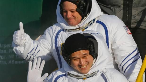US astronaut Scott Tingle, above, and Japanese astronaut Norishige Kanai, crew members of the mission to the ...