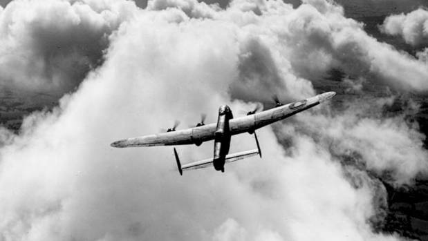 An atmospheric photograph of a RAF Lancaster bomber, used in World War II.