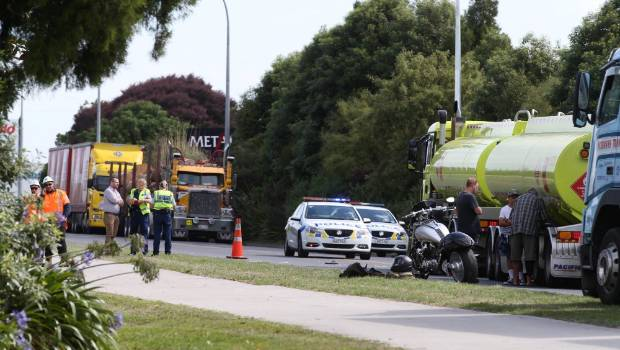 Man injured after stepping in front of truck in Hamilton