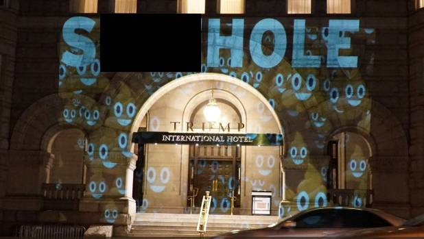 'SHITHOLE' projected onto Trump Hotel in DC