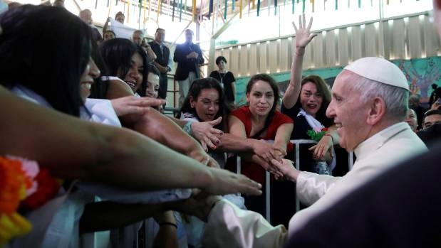 Pope Francis greets inmates at the San Joaquin women's prison in Santiago Chile