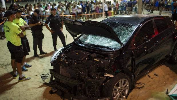 Vehicle  drives into crowd at Copacabana Beach in Rio; 11 hurt