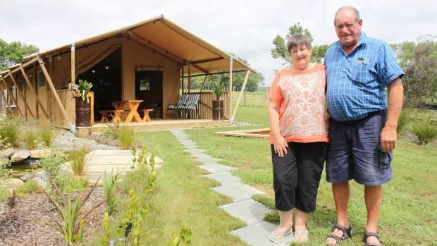 Brenda and Bruce Teddy outside their glamping tent in Te Uku, Raglan.