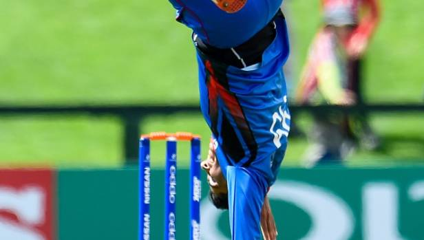 Spinners storm Afghanistan into semi-finals