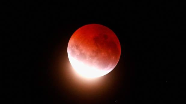 A blood red moon lights up the sky during a total lunar eclipse seen from Auckland in 2015. The moon will take on a red