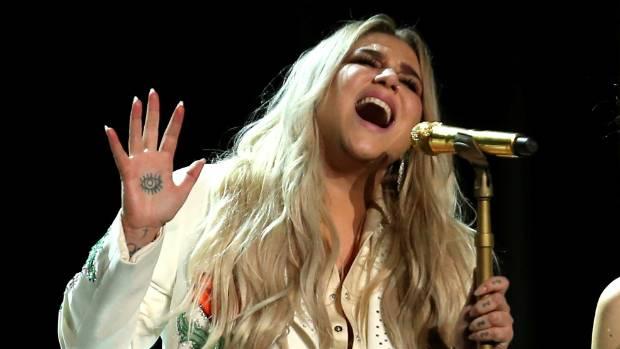 Kesha postpones tour dates to undergo surgery