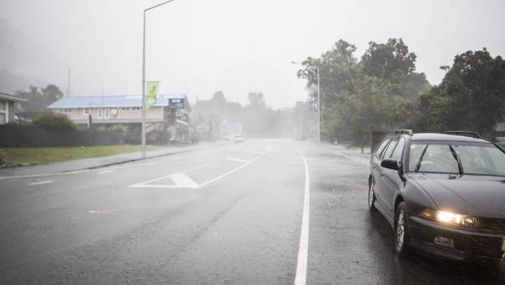 Torrential rain has begun moving slowly up the West Coast, with more than half a metre expected in places close to the main divide. File pic: Heavy rain at Franz Josef settlement.