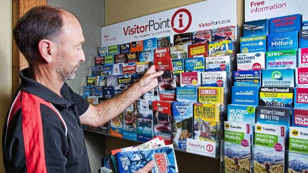 VisitorPoint's South Island distribution manager Grant Aitken filling one of the 2000 brochure stands the company ...