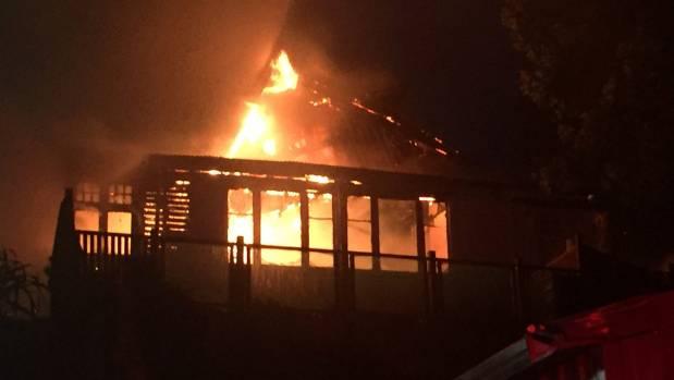 A Paekākārikihouse is ravaged by flames.