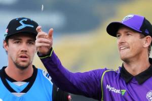 George Bailey of the Hobart Hurricanes  and Travis Head of the Adelaide Strikers toss the coin ahead of a Big Bash ...