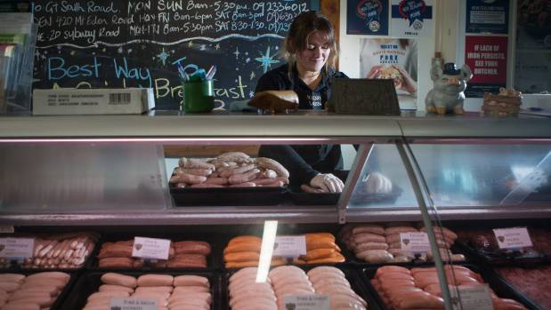 Sam Curley from Pokeno Bacon making sure the sausages are neatly arranged.