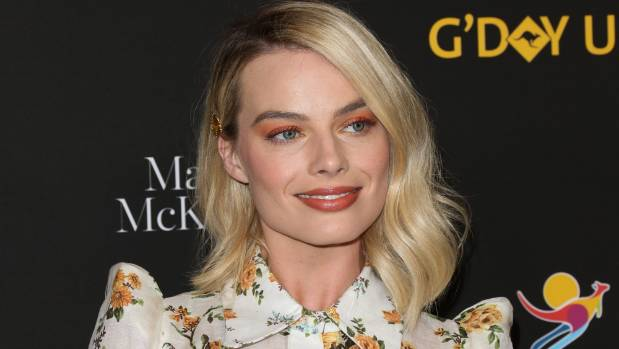 Peach eyeshadow? Margot Robbie makes it work.