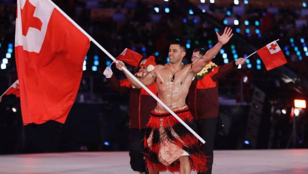 Shirtless and oiled-up Pita Taufatofua carries the flag of Tonga during the opening ceremony of the 2018 Winter Olympics