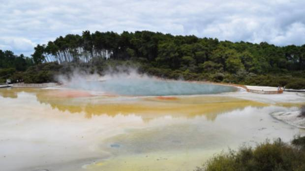 Minerals give the Champagne Pool at Wai-O-Tapu Thermal Wonderland its trademark colour. At the surface, the water is ...