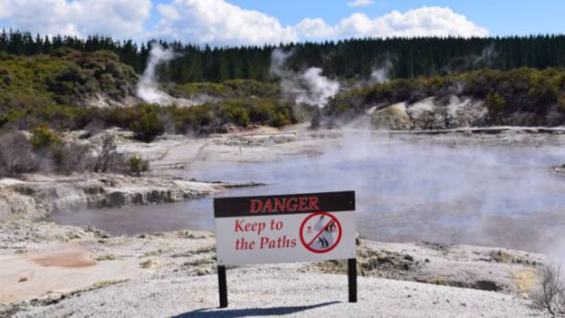 A warning sign at Hell's Gate thermal park, 50 acres of steaming, rumbling geothermal landscape.