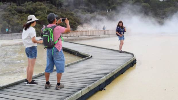A boardwalk crosses the steaming pool at Wai-O-Tapu Thermal Wonderland. The structure rests on specially treated timber ...