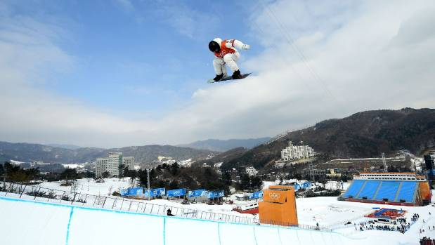 Snowboarding: White delivers again to win third halfpipe gold