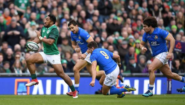 Bundee Aki's Ireland ran in eight tries in a 59-16 rout of Italy.