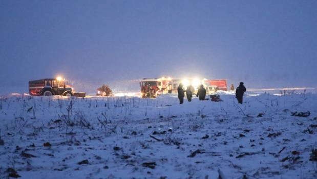 Russian Ministry for Emergency Situations employees work at the scene of the plane crash