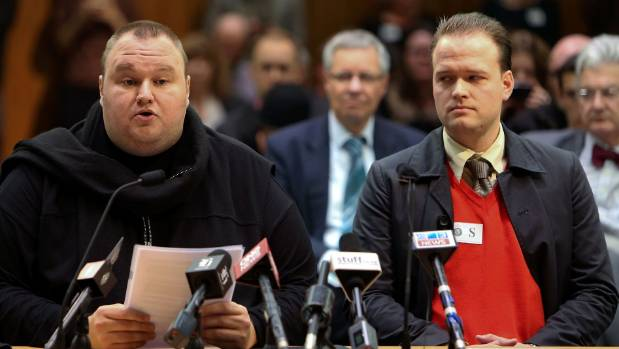 Kim Dotcom speaks while Bram van der Kolk looks on during an Intelligence and Security Committee hearing at Bowen House ...