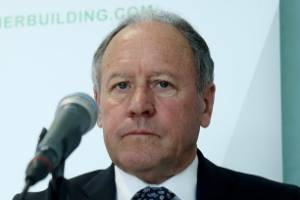 A stoney-faced outgoing Fletcher Building chairman Ralph Norris fronts a media conference over the company's mounting ...