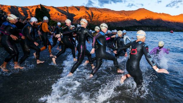 Swimmers launch at the start of the 2017 Challenge Wanaka.