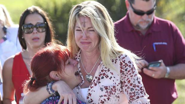 Parents waiting for news after a reports of the shooting at Marjory Stoneman Douglas High School on February 14
