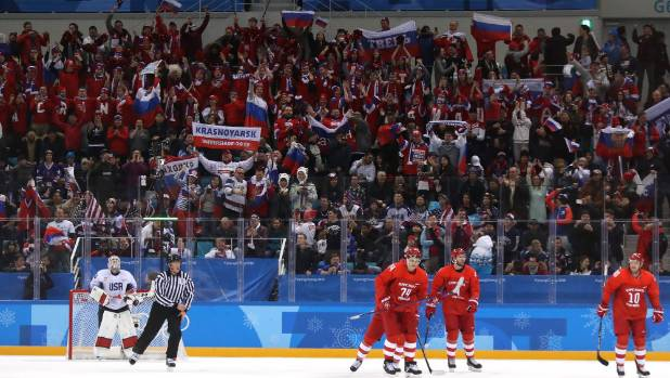 Russian flags fly with pride at the ice hockey as the Olympic Athletes from Russia team took on the USA.